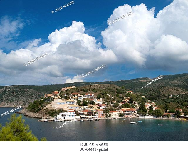 Greece, Kefalonia, Assos,view of sunny coastal village on hillside