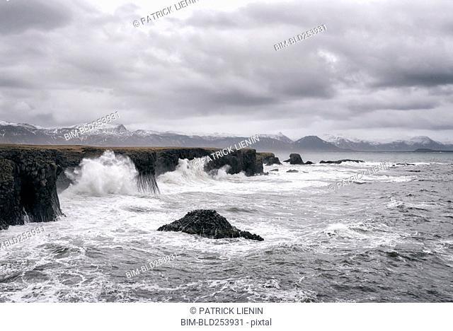 Ocean waves splashing on cliffs, Hellissandur, Snaellsnes peninsula, Iceland