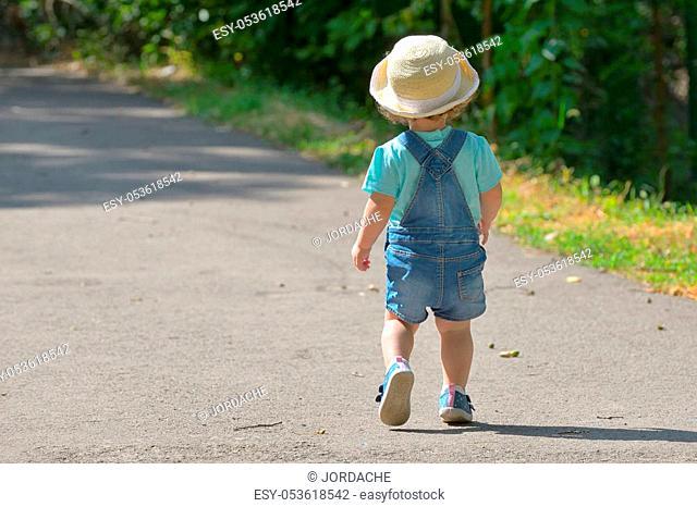 Little girl alone on street in summer
