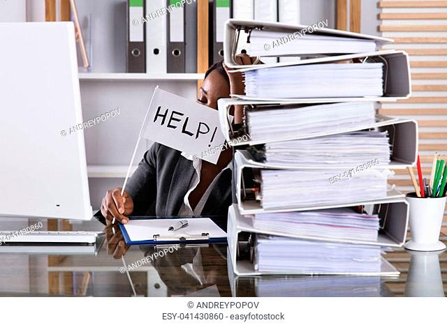 Stack Of Folders In Front Of A Tired Woman Holding Flag With Help Text