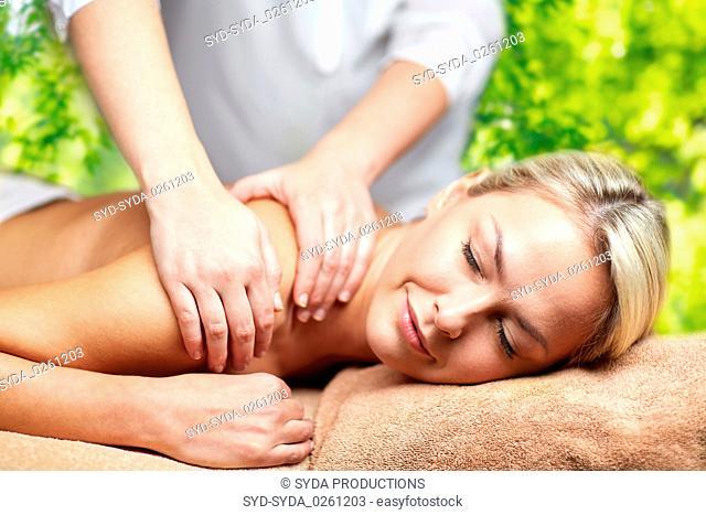 woman having back massage in spa