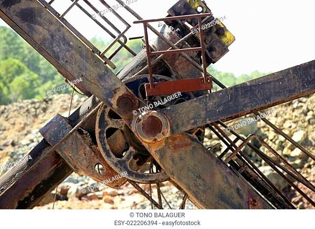 Excavator bulldozer arm wheel rusted detail