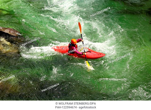 A paddler in his kayak in action on the river Soca near Bovec in Slovenia on July 09, 2019. Photo: Wolfram Steinberg/dpa   usage worldwide
