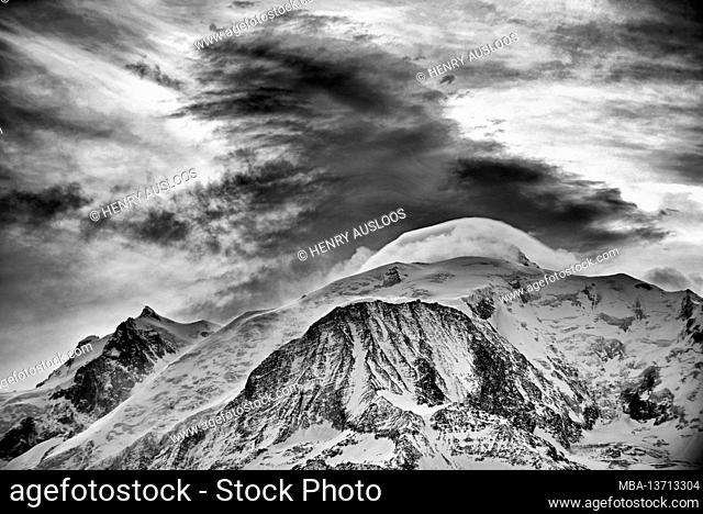 France, Haute Savoie, Mont Maudit (4465m left), Mont Blanc (4810m back), Dent du Gouter (3863m front) and clouds