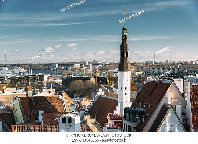 Tallinn, Estonia. Tower Of Church Of Holy Ghost Or Holy Spirit Is Medieval Lutheran Church Located Behind Raekoja Plats, Opposite Great Guild And Maiasmokk And...