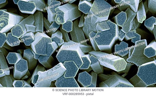 Animated coloured scanning electron micrograph (SEM) of crystals of zinc oxide (ZnO). This is a white powder that is used as a pigment in paints and in topical...