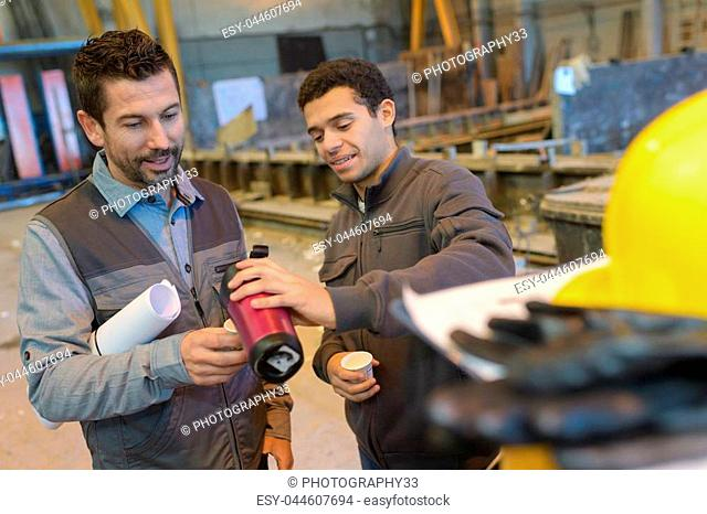 warehouse workers having a break with coffee