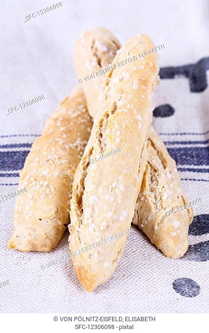 Spelt salt sticks on a linen cloth