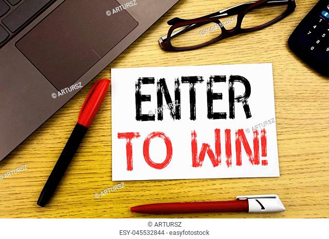Conceptual hand writing text showing Enter to Win. Business concept for Winning in Competition written on paper, wooden background in office copy space