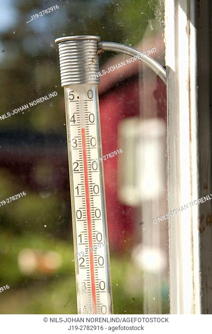 Thermometer in a window, countryside of northern Sweden