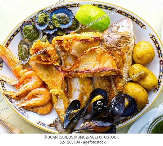 Traditional gastronomy: local fish, mussels, limpets, shrimps and 'papas arrugadas', Canary Islands, Spain