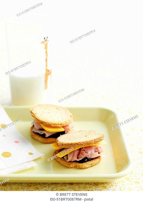 Tray of sandwiches with milk