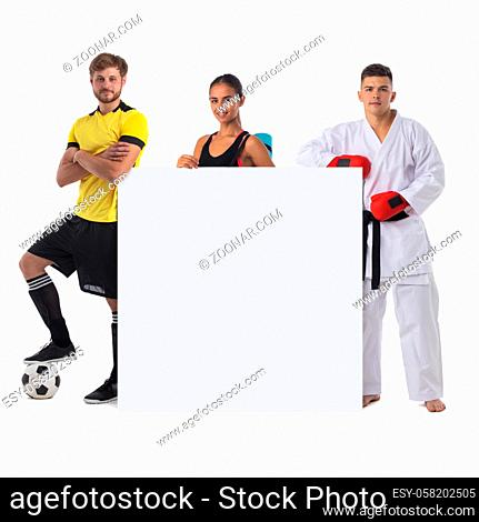 Group of sports people presenting empty banner with copy space for text isolated on white background