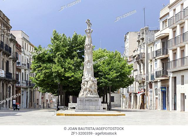 City view, street and sculpture Als Castellers, Penedes region,Catalonia