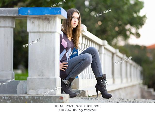 Teenager girl outdoors and pants and ankle-boots