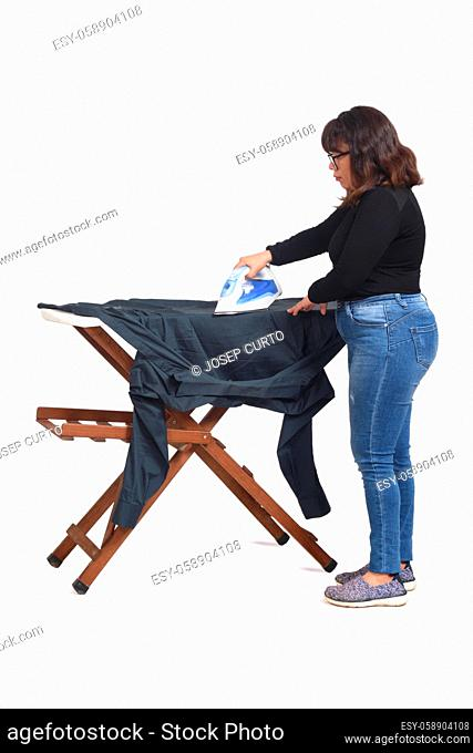 rear view of a latin woman ironing on white background