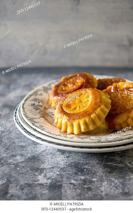 Upside down orange cakes on a plate