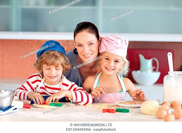 Happy mother baking with her children