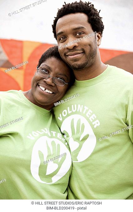 African American volunteers hugging