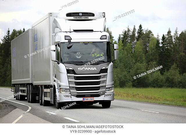 Uurainen, Finland - August 25, 2018: Silver Next generation Scania R500 of Mattila pulls Thermo King refrigerated trailer along highway in the summer