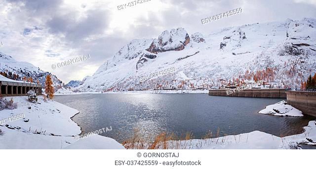 Romantic lake Fedaia with snowy Christmas atmosphere in the Dolomites