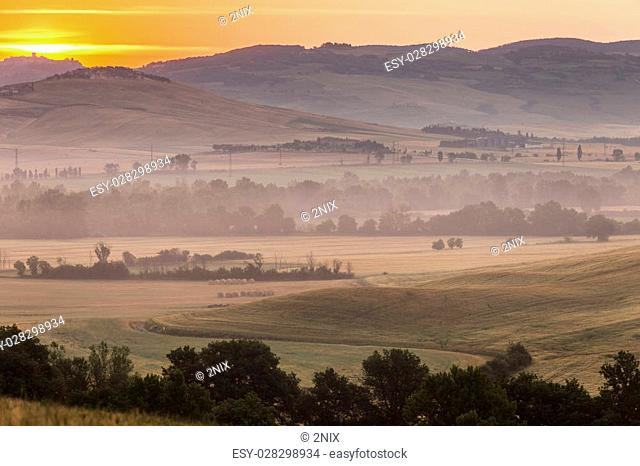 Early morning on countryside, San Quirico d'Orcia, Tuscany, Italy