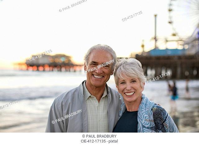Portrait of smiling senior couple at beach