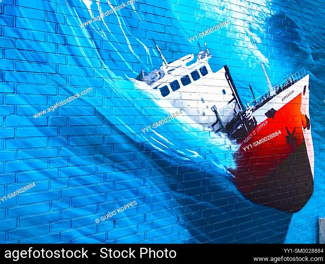 Rotterdam, Netherlands. Huge Mural & Graffity of a fishing vessel being thrusted by a Huge, killer wave, somewhere out on the North Sea