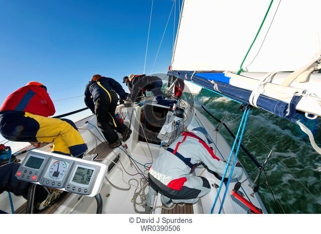 An busy offshore yacht racing crew sailing