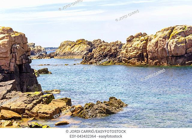View of the cliffs of the island of Bréhat, the Côtes-d'Armor in the Bretagne, in the low sea