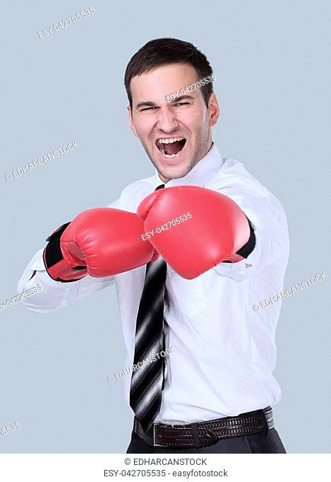 Business man with boxing gloves is ready for corporate battle