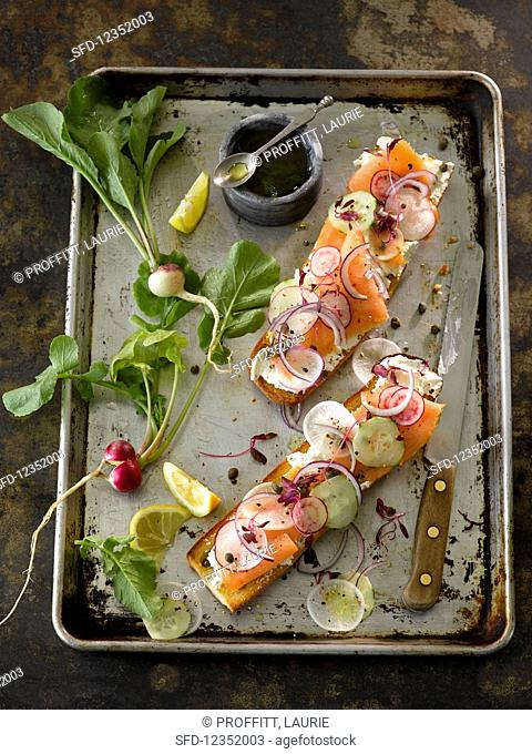 A smoked salmon baguette with radish