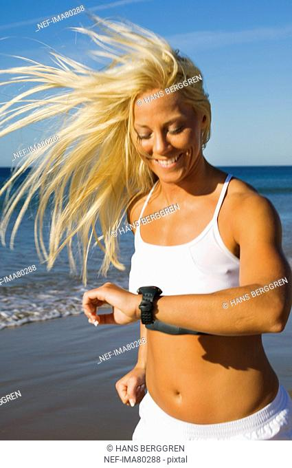 A blond woman running on a beach, Portugal