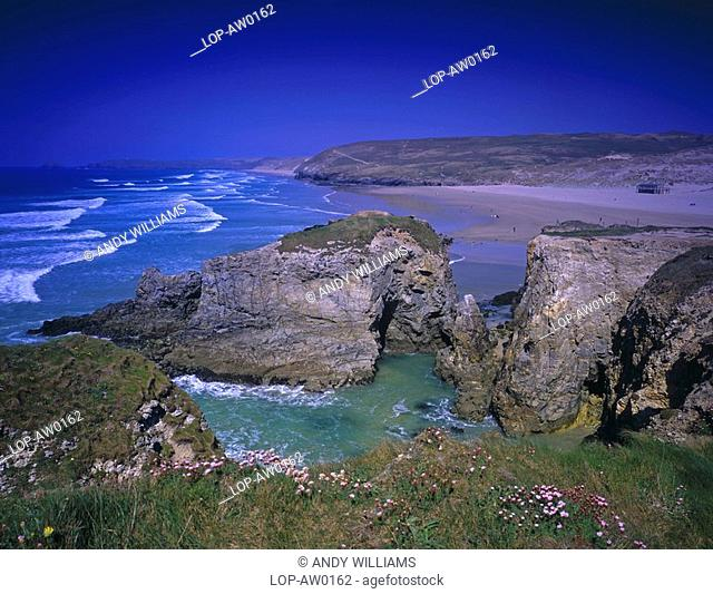 England, Cornwall, Perranporth, Blue skies over the rocky shores of Perranporth