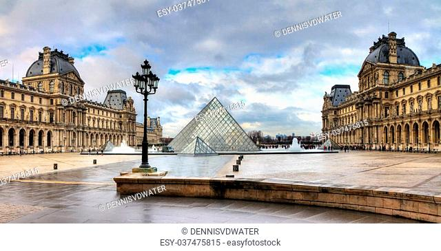 Beautiful view of the Louvre in Paris on a cloudy winter day