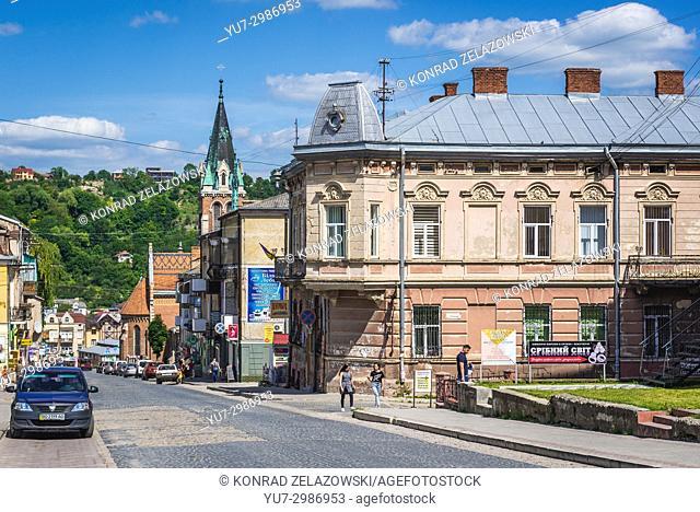Stepan Bandera street in Chortkiv city in Ternopil Oblast of western Ukraine. Bell tower of Saint Stanislaus Church on background