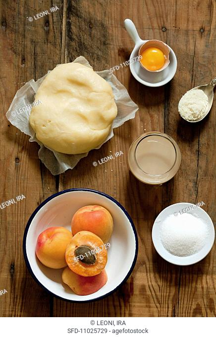 Ingredients for apricot cake short pastry, apricots, sugar, egg yolk, flour