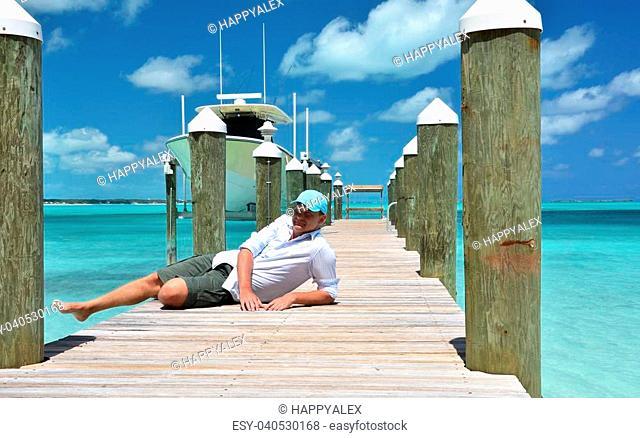 Man on the wooden jetty. Exuma, Bahamas