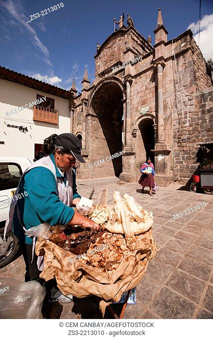 Indigenous vendor selling food at the street in town center, Cuzco, Peru, South America