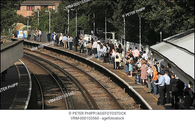 Commuters at a station in west London
