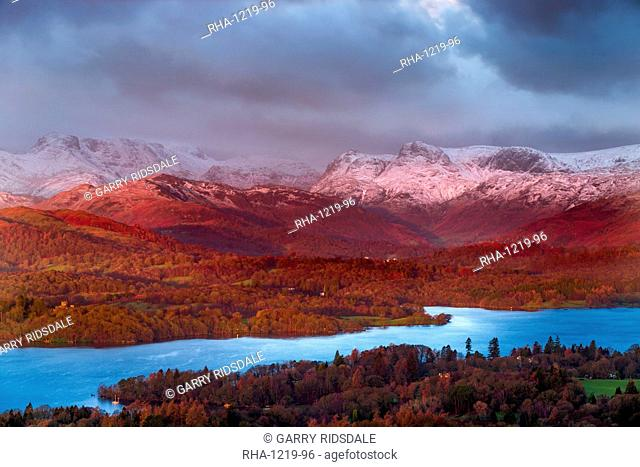 Looking across Lake Windermere to the snow capped Langdale Pikes on a winters morning in the Lake District National Park, Cumbria, England, United Kingdom