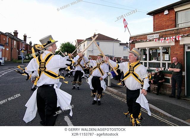Morris dancers performing outside a public house in Bitterne, Southampton, Hampshire, England