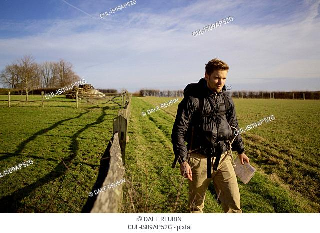 Male hiker walking in field
