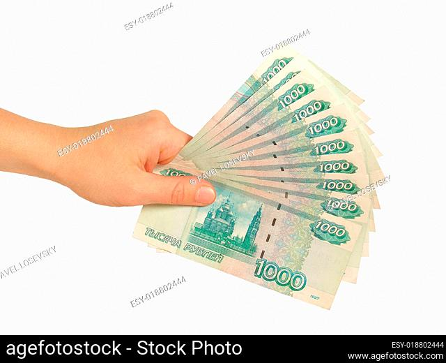 girl's hand with rubles