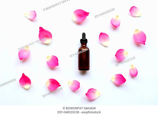 Lotus essential oil with lotus petals on white background