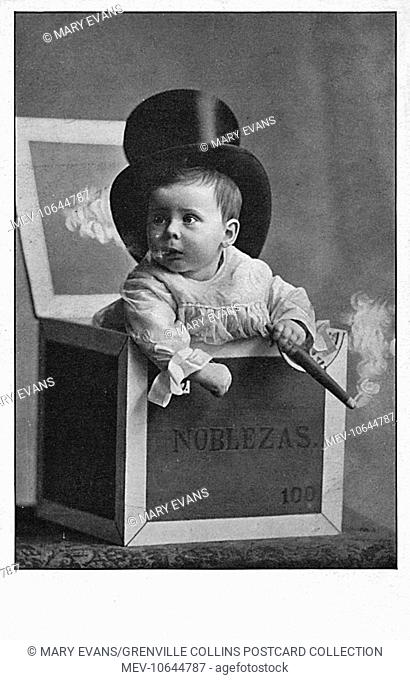 Smoking Baby in a cigar box wearing a silk top hat. Not the best start in life health-wise.. Quite bizarre