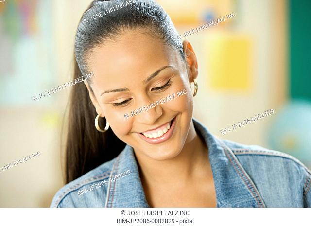 Female Dominican teenager smiling in classroom