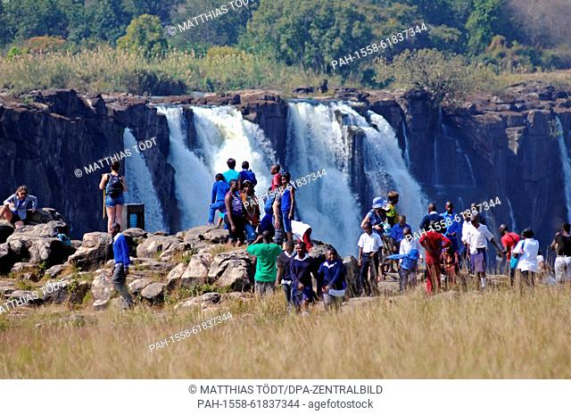 Numerous visitors at the Zimbabwean side of the Victoria Falls, pictured on 30.07.2015. The Victoria Falls are the broad waterfalls of the Zambezi at the border...