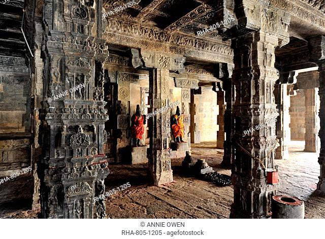 Two dressed deities at shrine inside pillared hall in 11th century Gangaikonda Cholapuram temple, UNESCO World Heritage Site, Ariyalur district, Tamil Nadu
