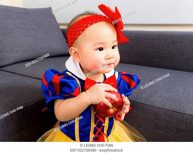 Baby girl with party dressing at home
